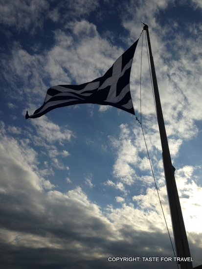 Greek flag on the Acropolis, Taste for Travel