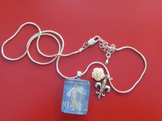 Vintage French stamp turned artfully into a pendant
