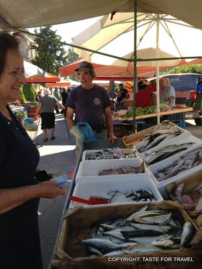 Chrisanthe buys sardines, Xylokastron market, Greece