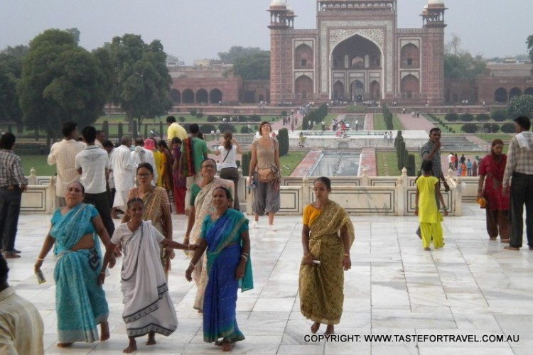 Indian women and tourists at the Taj Mahal