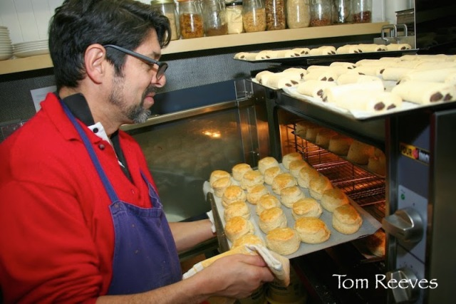 Marc, Owner Les Petits Plats de Marc 6 rue de l'Arbalète, takes scones out of the oven