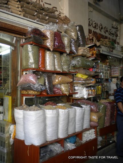 Sacks of pulses and a wall of spices in Dubai's Old Town