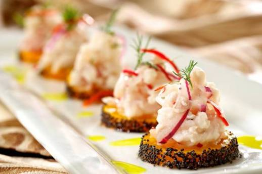 Franco's sea bass ceviche over a toasted poppy seed pumpkin round with mustard oil garnish